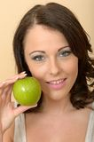 Heathy Young Woman Holding Fresh Ripe Juicy Green Apple Stock Photo