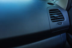 Heating and air conditioning unit of a car. Traditional model. The close up of heating and air-conditioning unit on the classy black head unit of a new neat car Stock Photography