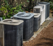Heating and air conditioning units. In back of an apartment complex royalty free stock image