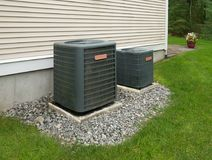 Heating and air conditioning units. In back of an apartment complex royalty free stock photography