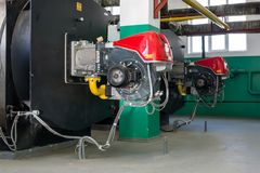 Heating boilers for heating water and gas burners. At the heating plant stock photo