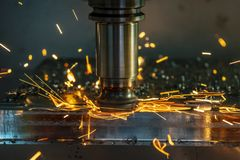 The  heating  chip on CNC machining centre  from tool wear. The CNC milling machine cutting the mold part with the index-able radius end mill tool in roughing stock image