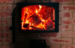 Heating concept. Fire from the furnace. Firewood in the oven. Royalty Free Stock Images