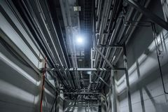 Heating or cooling water pipes on ceiling of industrial or office building stock images