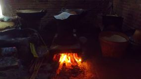 Heating dough on a fire to make spaghetti in an old fashioned way on Java Indonesia. Asia stock footage