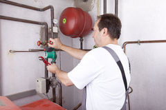 Heating Engineer At Work Stock Photos
