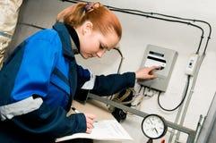 Heating engineer in boiler room Royalty Free Stock Image