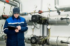 Heating engineer in boiler room Royalty Free Stock Image