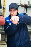 Heating engineer in boiler room Stock Images