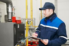 Heating engineer in boiler room Stock Photography