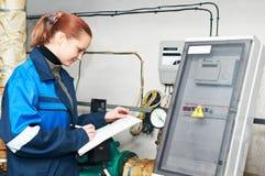 Heating engineer in boiler room Royalty Free Stock Photos