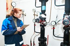 Heating engineer in boiler room Royalty Free Stock Photography