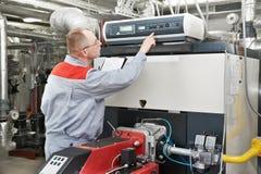 Heating engineer in boiler room Stock Photography