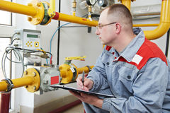 Heating engineer in boiler room Royalty Free Stock Images