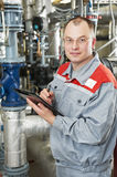 Heating engineer in boiler room Stock Photos