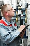 Heating engineer in boiler room Royalty Free Stock Images