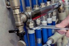 Free Heating Engineer Installing Modern Heating System In Boiler Room. Royalty Free Stock Photo - 187770735