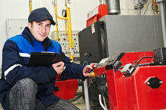 Heating engineer repairman Stock Photos