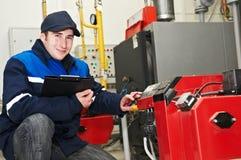 Heating engineer repairman Stock Photos
