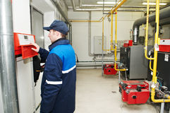 Heating engineer repairman. Maintenance repairman engineer operating of heating system equipmant in a boiler house Stock Photos