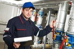 Heating engineer repairman in boiler room Stock Photos