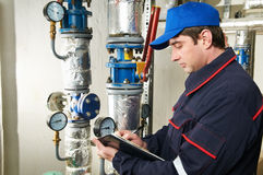 Heating engineer repairman in boiler room Royalty Free Stock Images