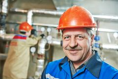 Heating engineer repairman in boiler room Royalty Free Stock Photos