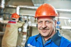 Heating engineer repairman in boiler room Royalty Free Stock Photos