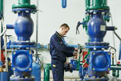Heating engineer repairman in boiler room Royalty Free Stock Photography