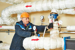 Heating engineer repairman in boiler room Stock Images