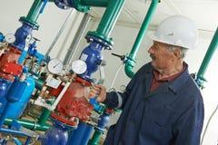 Heating engineer repairman in boiler room Royalty Free Stock Images