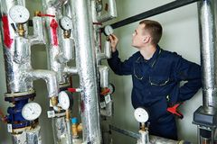 Heating engineer repairman in boiler room Stock Image