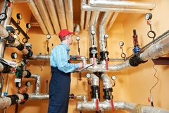 Heating engineer repairman in boiler room Stock Photography