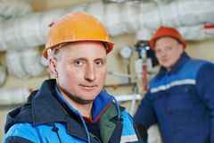 Heating engineer repairman in boiler room Royalty Free Stock Photo