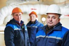Heating engineer repairmans in boiler room Royalty Free Stock Photography