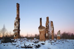 Heating furnaces on the ashes of the burned-down two-storeyed house in the January evening. Lenin Stock Images