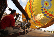 Heating hot air balloon before lift Royalty Free Stock Images