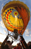Heating hot air balloon before lift Stock Photo