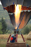 Heating the hot air balloon before lifting off stock photo