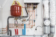 Heating installation, household boiler with heat pomp new stock image