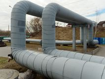 Heating main. large diameter pipes are sharply curved.  royalty free stock photos