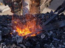 The heating of metal billets on hot coals Royalty Free Stock Photos