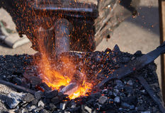 The heating of metal billets on hot coals Stock Photo
