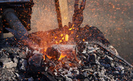 The heating of metal billets on hot coals Stock Images