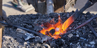 The heating of metal billets on hot coals Royalty Free Stock Image