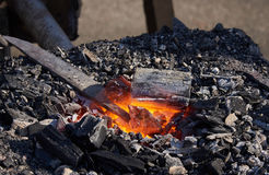 The heating of metal billets on hot coals Stock Image