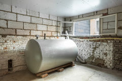 Heating oil tank. In a separate room in a old building, there is a heating oil tank Royalty Free Stock Photos