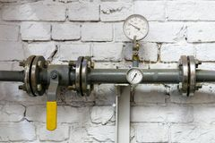 Free Heating Pipe With Pressure Gauge, Valve And Fittings, Against A Brick Wall Stock Image - 163169321