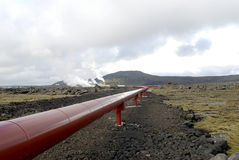 Heating pipes in Iceland. Pipes from heating plant in lava field in Iceland Royalty Free Stock Photo
