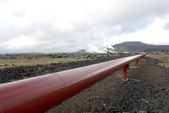 Heating pipes in Iceland. Pipes from heating plant in lava field in Iceland Stock Photos